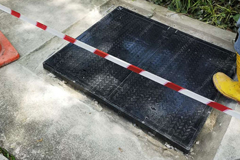 Singapore rainwater manhole cover pilot